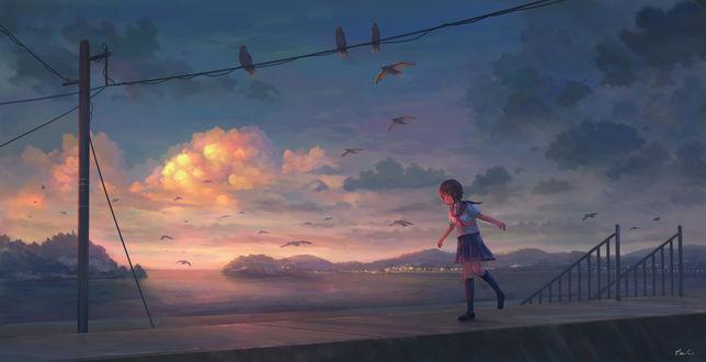 Фото Девочка идет по набережной в сумерках