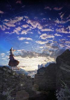 Фото Девочка стоит на развалинах под облачным небом