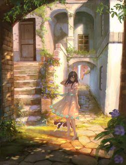 Фото Девушка стоит у дома рядом с кошкой
