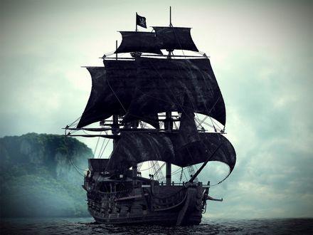 Фото Пиратский корабль с черными парусами стоит у необитаемого острова