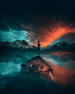 Фото Парень стоит на крыше затопленного дома