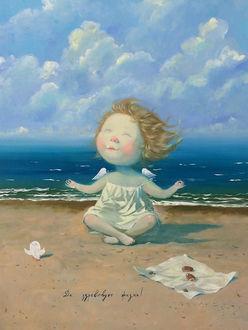 Фото Девочка-ангел на берегу моря в позе лотоса