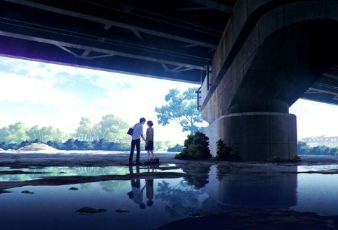 Фото Парень с девушкой стоят под мостом