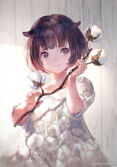 Фото Девочка держит в руке ветку хлопка