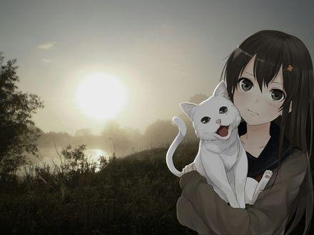 Фото Девушка держит белую кошку на руках