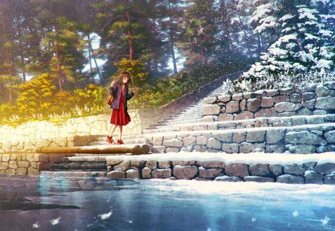 Фото Девочка стоит на ступеньках между двумя временами года-осенью и зимой