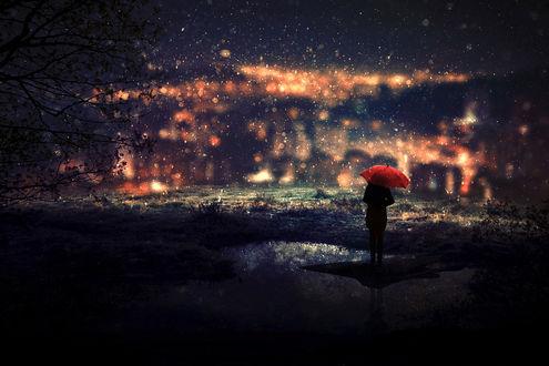 Фото Девушка с красным зонтом стоит на фоне ночных огней города под первым снегом, by BaxiaArt