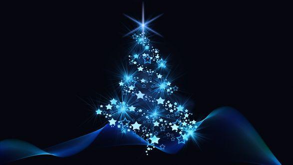 Фото Новогодняя елка с неоновым синим свечением на темном фоне