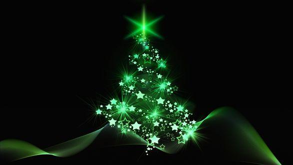 Фото Новогодняя елка с неоновым зеленым свечением на темном фоне