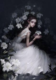 Фото Девушка-эльф у белых лилий