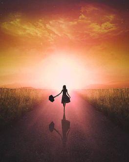 Фото Девушка с зонтом в руке идет по дороге, by Steven Konrad