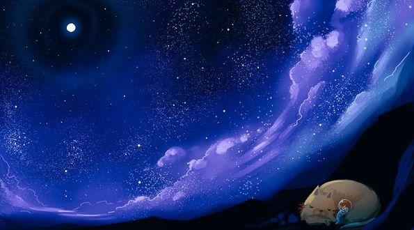 Фото Ребенок спит рядом со спящей кошкой под облачным звездным небом
