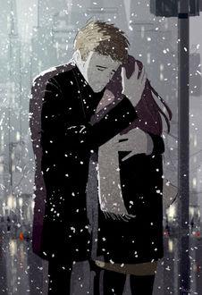 Фото Парень обнимает девушку, оба стоят под падающим снегом