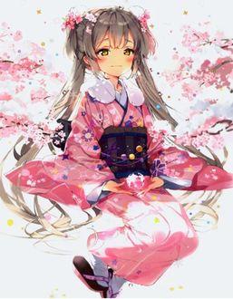 Фото Девочка с длинными волосами в розовом кимоно сидит среди цветущей сакуры