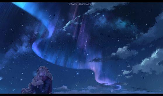 Фото Девушка пытается согреть руки, стоя на фоне ночного неба и северного сияния, by megatruh