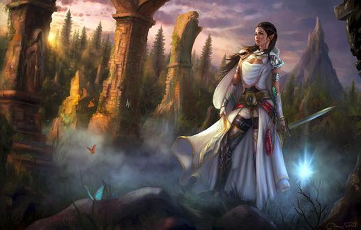 Фото Эльфийка с мечом стоит на фоне природы и руин древнего замка, by Jorsch