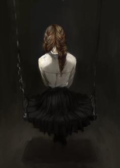 Фото Девушка сидит на качелях в пустой темной комнате