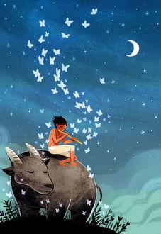 Фото Парень сидит на буйволе и играет на дудочке, извлекая волшебные звуки, by Borg Sinaban