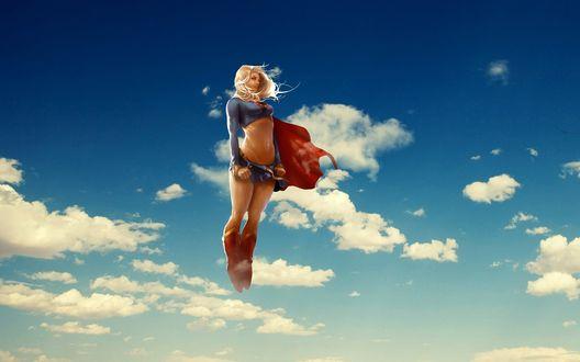 Фото Девушка-блондинка, супергероиня, взлетает в небо