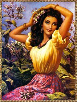 Фото Красивая девушка с цветами в волосах и с бусами на шее