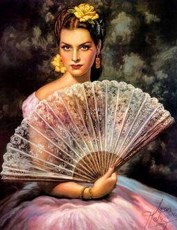 Фото Красивая ретро девушка с веером в руке и цветком на голове
