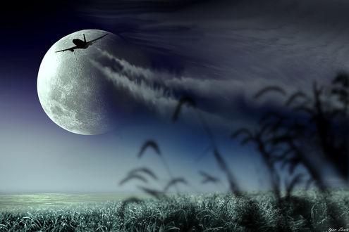 Фото Самолет в небе на фоне полной луны. Фотохудожник Igor Zenin