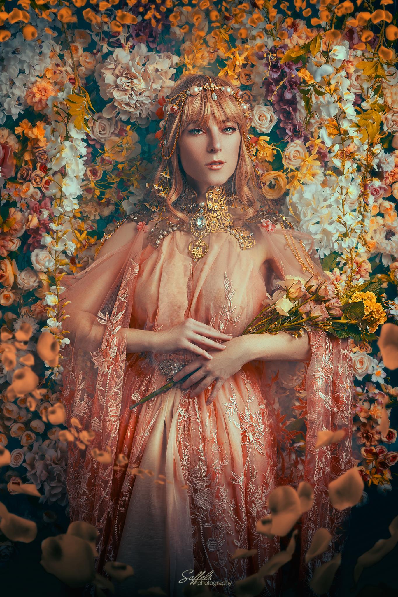 Фото Девушка в образе Ostara- богини весны с украшением на голове стоит в окружении цветов, by Firefly-Path