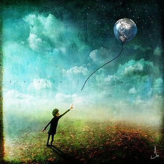 Фото Мальчик отпускает шарик с изображением Земли