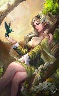 Фото Эльфийка держит птичку колибри на руке, by Jackie Felix