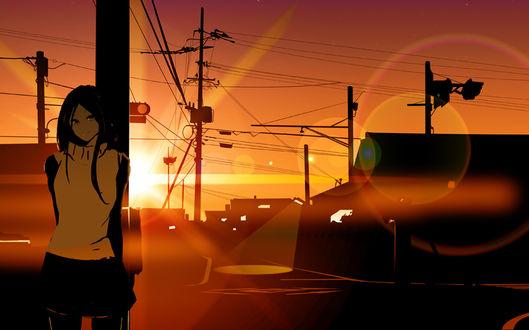 Фото Девушка в лучах заходящего солнца на улице города