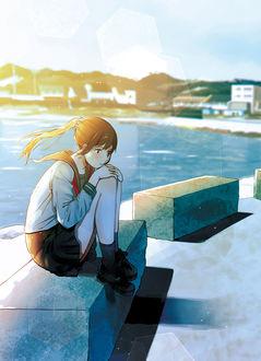 Фото Грустная школьница сидит на бетонном блоке возле воды