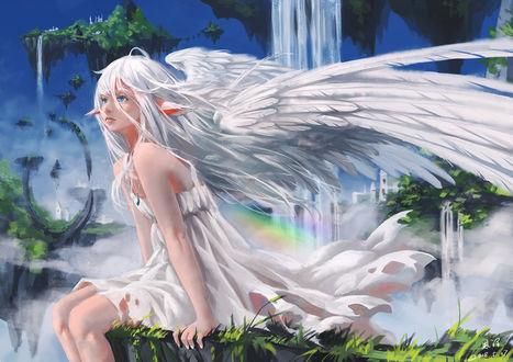 Фото Девушка с ангельскими крыльями за спиной сидит на парящем острове