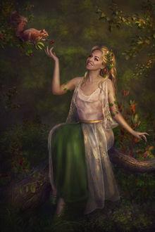 Фото Сказочная девушка красавица сидит в лесу с цветами в волосах на фоне белочки, которая подает ей ягоды, by Lotta-Lotos