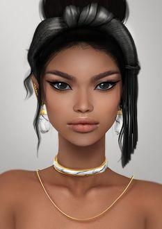 Фото Восточная красавица с раскосыми глазами с украшением на шее и в сережках