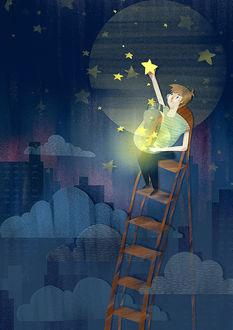 Фото Парень вешает на небо звезды
