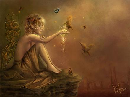 Фото Фантастическая девушка-эльф с крылышками сидит на скале с птицей на руке на фоне бабочки, by Veronica Atanacio