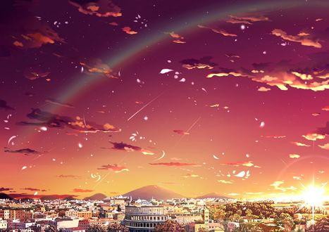 Фото Радуга и падающие звезды в закатном небе над городом