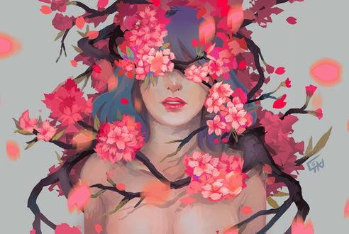 Фото Девушка в ветках с цветущими весенними цветами