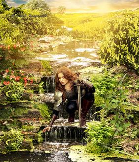Фото На ступеньках с водой, девушка в доспехах наклонилась за подковой