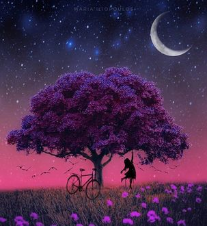 Фото Девушка под цветущим весенним деревом