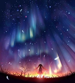 Фото Девочка на фоне неба с северным сиянием