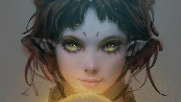 Фото Эльфийская девочка, смотрит острым взглядом, около светящийся сферы