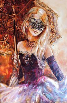 Фото Таинственная незнакомка в маскарадной маске, отпустила глаза держа зонтик в руке