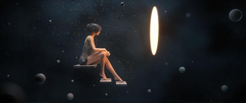 Фото Девушка сидит перед светящимся диском