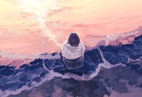 Фото Девушка сидит на морском берегу