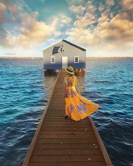 Фото Девушка в шляпе и длинном платье идет по мостику к домику над морем, by Dotz Soh