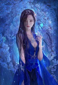 Фото Грустная девушка в голубом платье стоит под дождем на фоне цветущих деревьев