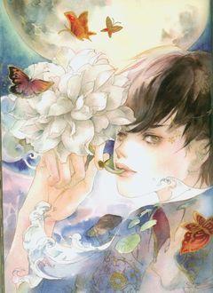 Фото Мальчик с цветком и бабочками над ним