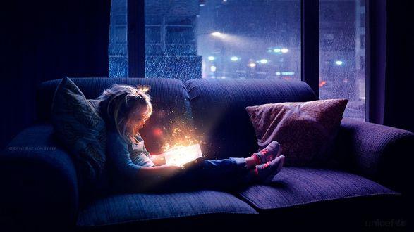Фото Девочка с волшебной книгой сидит на диване, by Ellysiumn Art