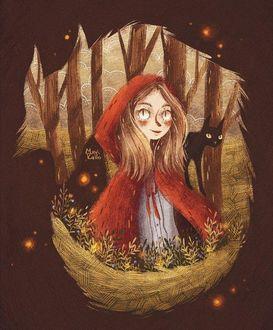 Фото Девушка в красном плаще с черной кошкой на плече на фоне осеннего леса